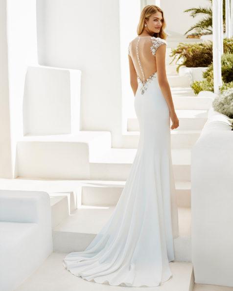 Mermaid-style crepe wedding dress with bateau neckline and low back with crystal flower appliqués, in natural and natural/rose.