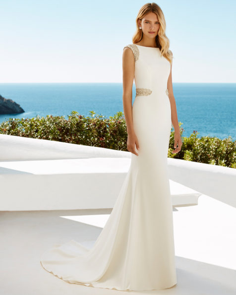Crepe sheath wedding dress with bateau neckline and jeweled back with frosted beading, in natural.