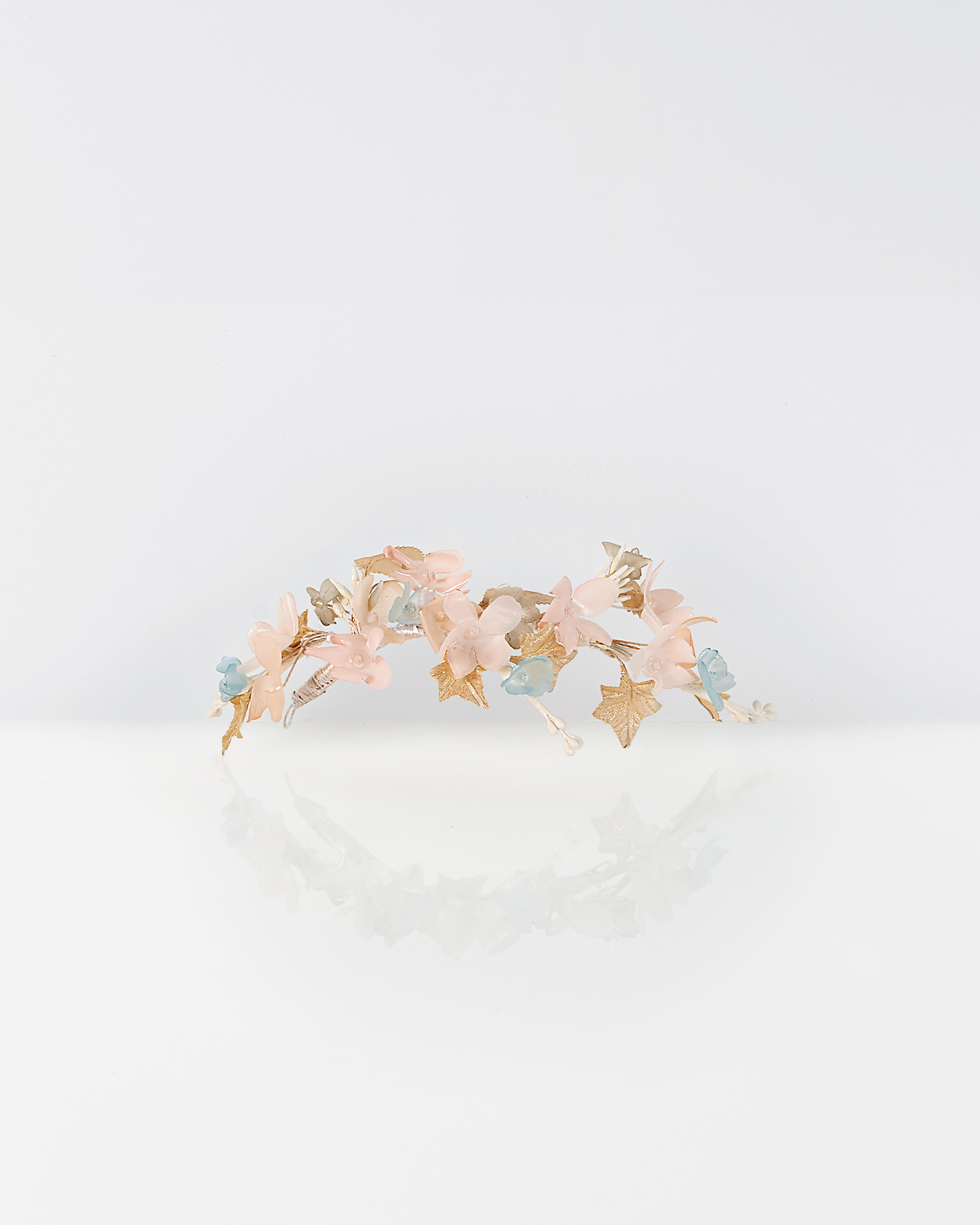 Polyvinyl and garza bridal headpiece, in pink/blue/gold. 2018  Collection.