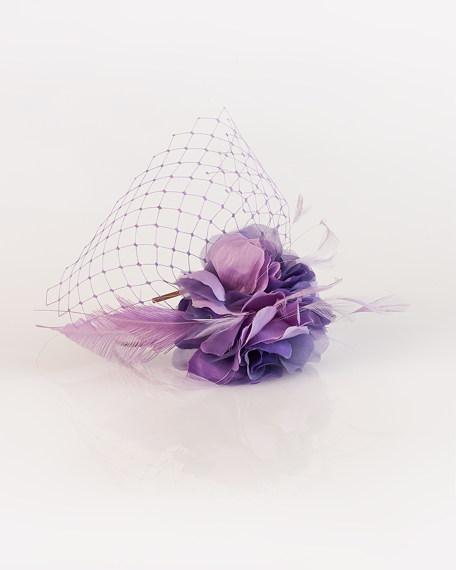 Garza, feather and net cocktail headpiece, available in terracotta, black and mauve. 2018  Collection.