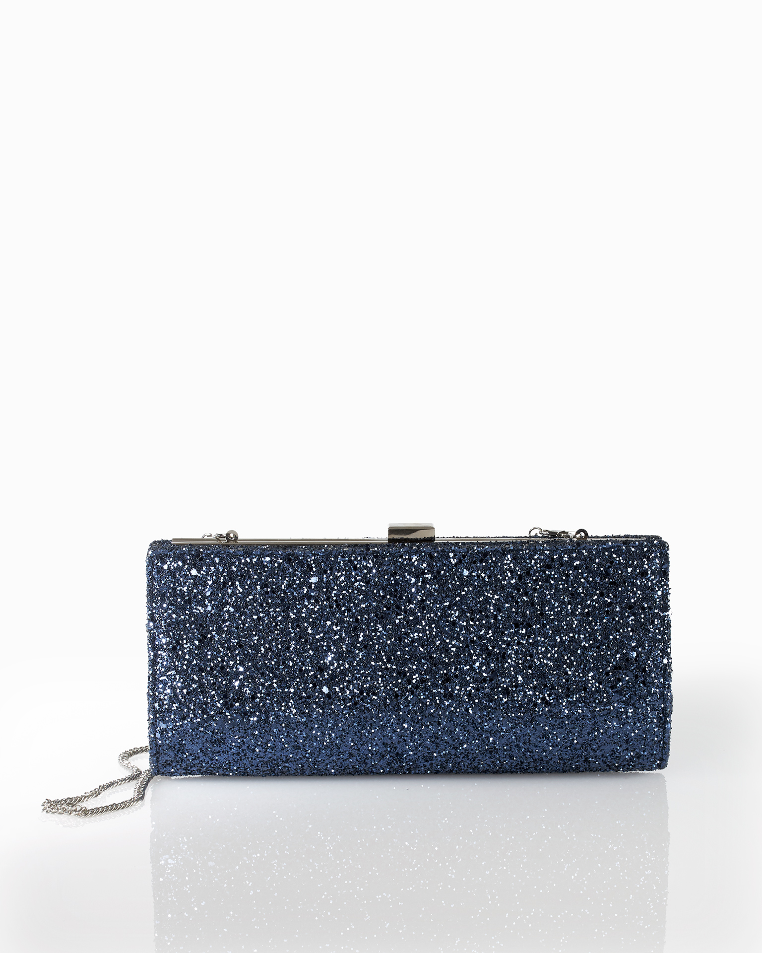 Clutch de cocktail en glitter, disponible en couleur noir, gris plomb, bleu marine, argent et champagne. Collection FIESTA AIRE BARCELONA 2018.