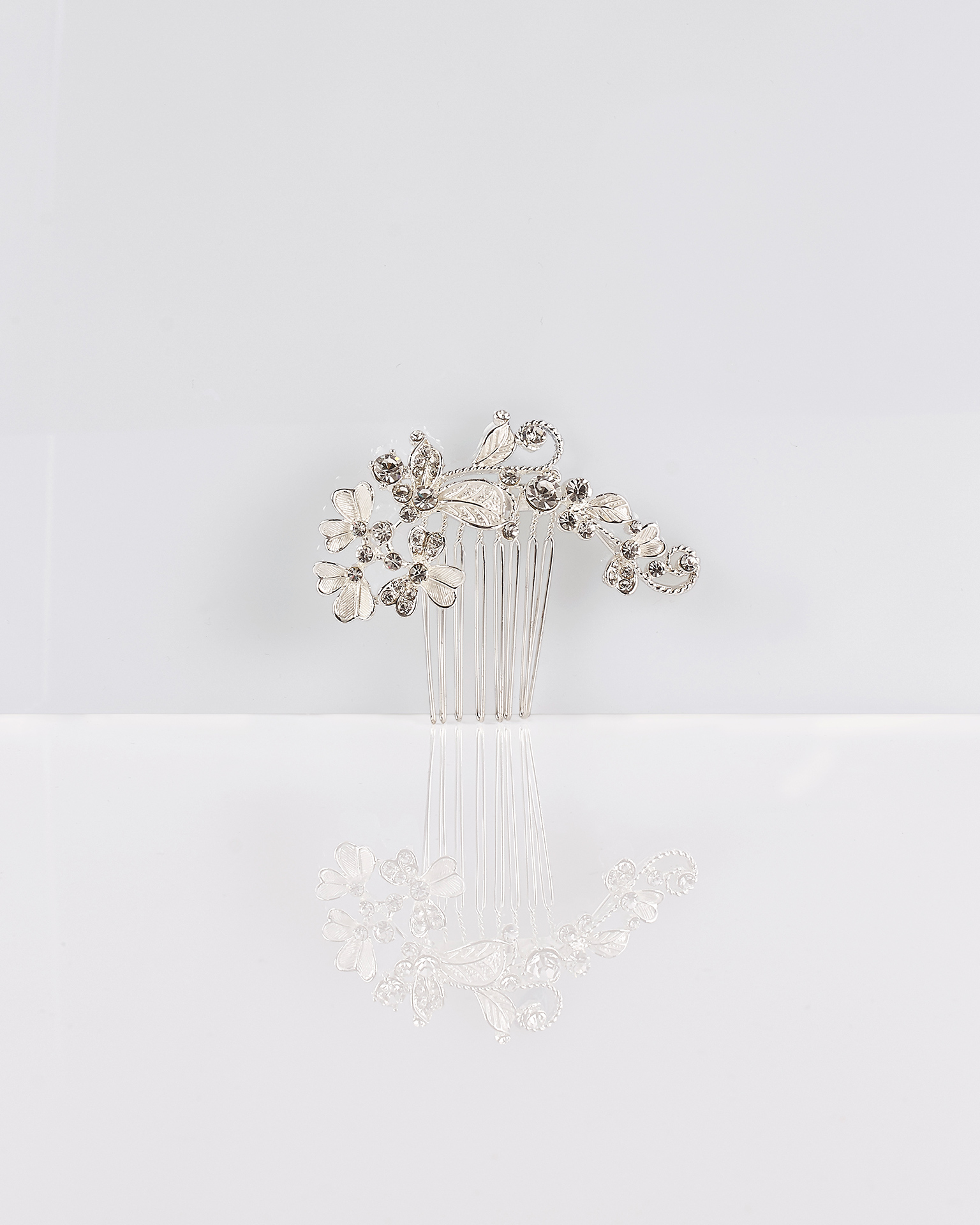 Flower and crystal mantilla comb, in silver. 2018  Collection.