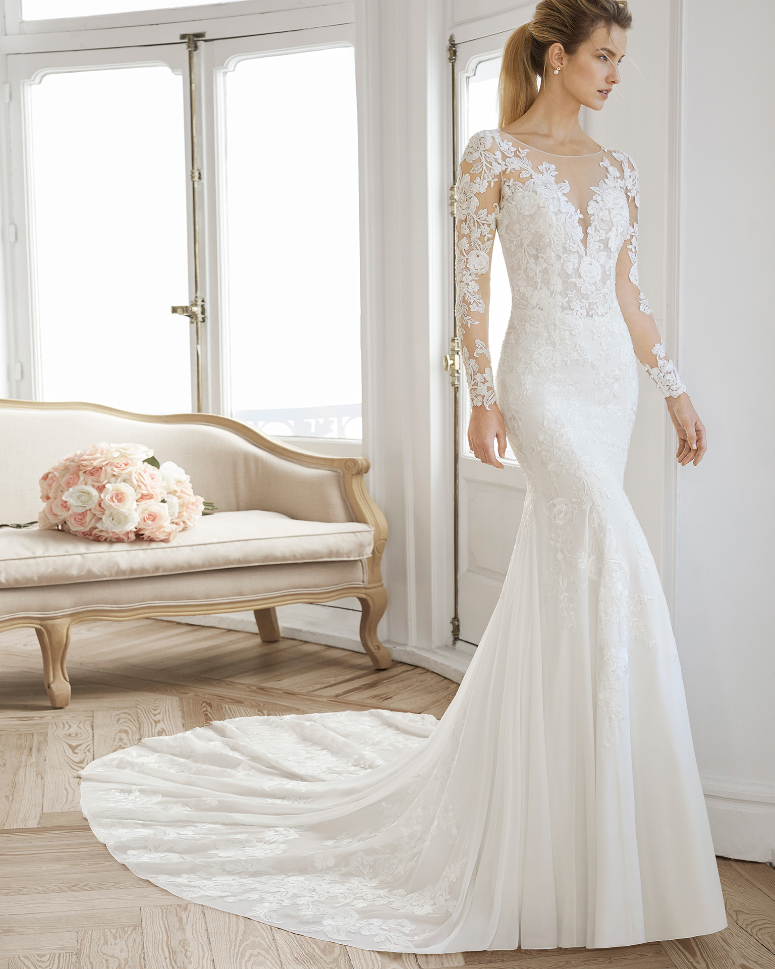 Mermaid-style wedding dress in crepe Georgette and beaded lace. Illusion neckline and long sleeves. Available in natural. 2019 AIRE BARCELONA Collection.