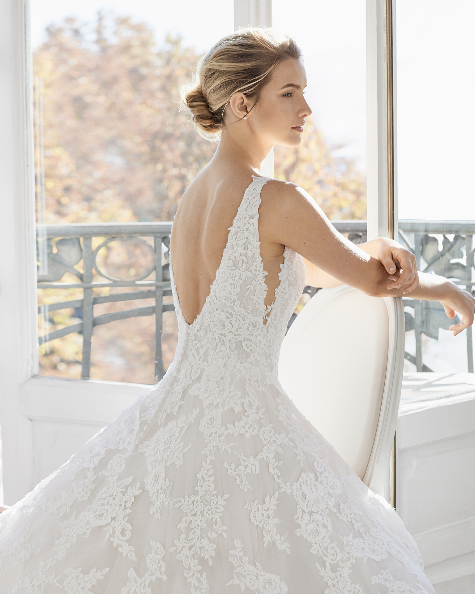 Romantic lace wedding dress. Deep-plunge neckline and low back. Available in natural/nude and natural/natural. 2019 AIRE BARCELONA Collection.
