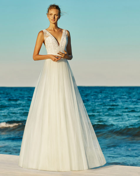 A-line beaded lace and soft tulle wedding dress. V-neckline and low back. Available in ivory. 2019 AIRE BEACH WEDDING Collection.