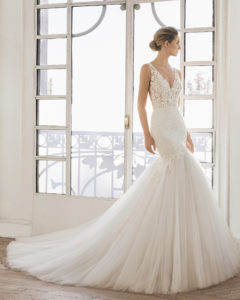 9150b0fa0a Mermaid-style beaded lace and tulle wedding dress. V-neckline and back.
