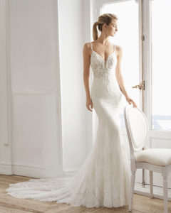 ea48b1d825 Mermaid-style wedding dress in beaded lace. Deep-plunge neckline with  beaded straps ...