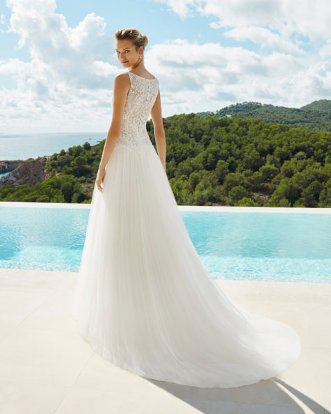A-line beaded lace and soft tulle wedding dress. Bateau neckline and lace back. Available in natural. 2019 AIRE BEACH WEDDING Collection.