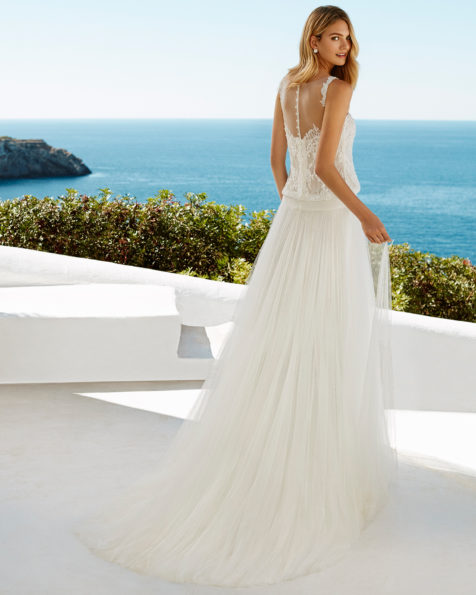 Boho-style beaded lace and soft tulle wedding dress. Square neckline and low back. Available in natural. 2019 AIRE BEACH WEDDING Collection.