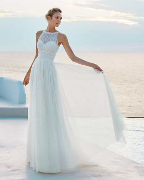A-line beaded lace and soft tulle wedding dress. Bateau neckline and low back. Available in natural. 2019 AIRE BEACH WEDDING Collection.