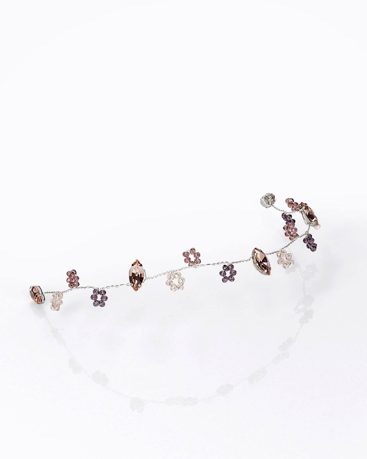 Toucado de noiva em prateado e cristais. Disponível em prateado e tons de rosa. Coleção AIRE BARCELONA 2019.