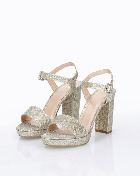 Sandalia de novia en rejilla. Con tacón alto. Disponible en color natural, oro y acero. Colección AIRE BARCELONA 2019.