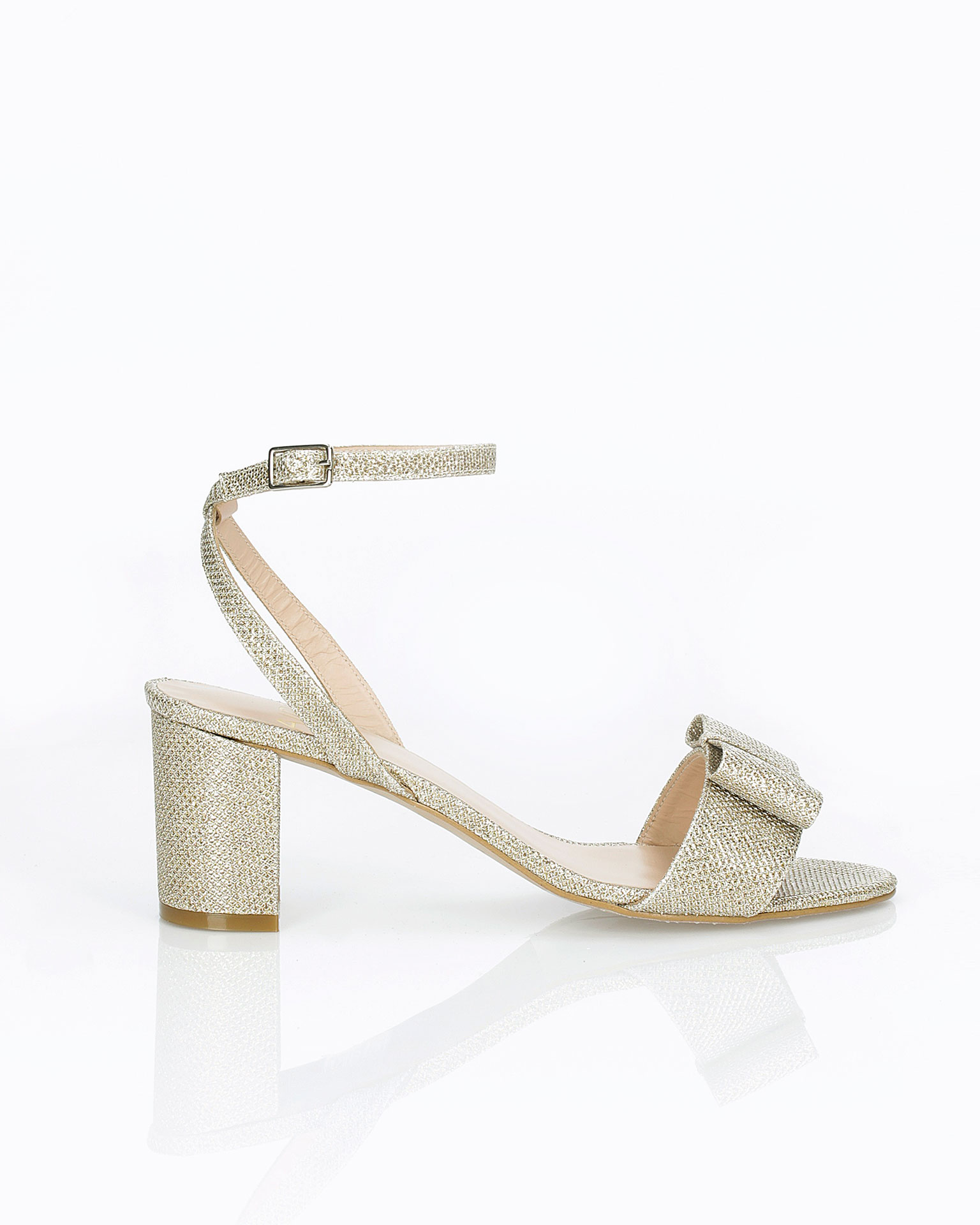 Woven fabric bridal sandal. With low heel, ankle strap and bow detail. Available in natural, gold and steel 2019 AIRE BARCELONA Collection.