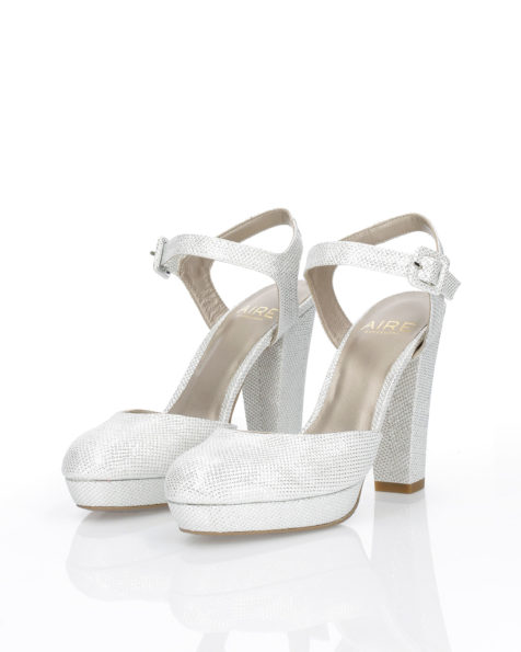 Woven fabric bridal shoe. With high heel and open back. Available in natural, gold and steel 2019 AIRE BARCELONA Collection.