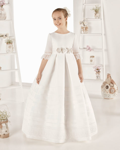 Classic basketweave First Communion dress with pin tucks. With empire waist. Available in ivory. 2019 AIRE COMUNION Collection.